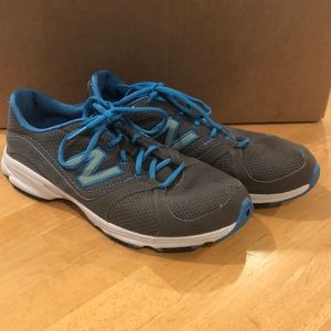 Blue and gray New Balance tennis shoes